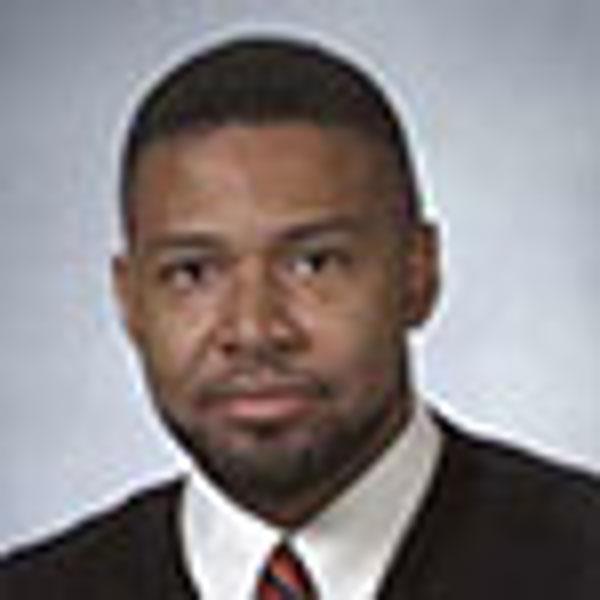 Dr. John E. Foster